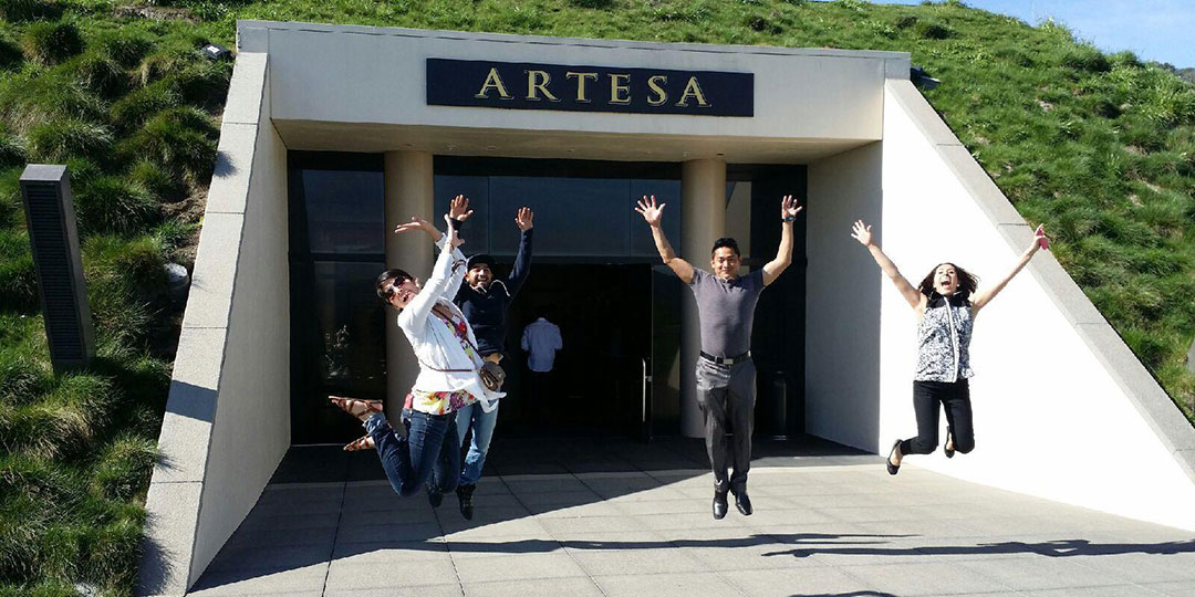 Guests jumping in front of Artesa Winery